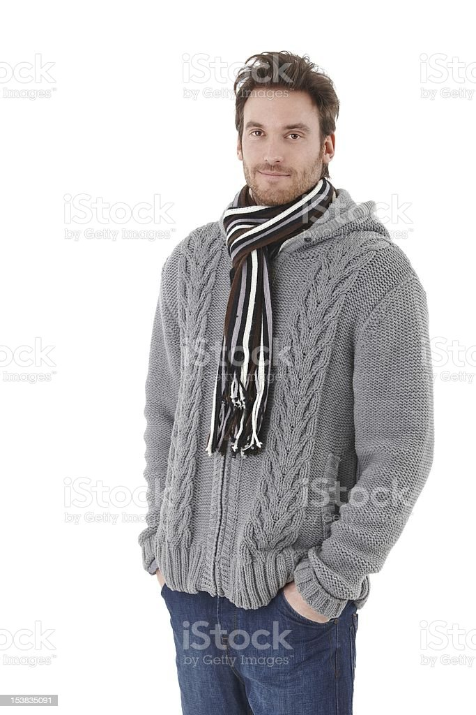 Young man dressed up warm smiling royalty-free stock photo