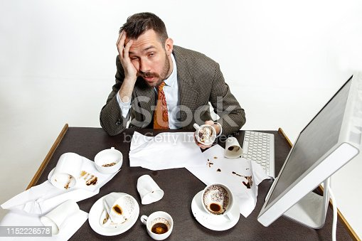 481644192 istock photo Young man drinking a lot of coffee 1152226578