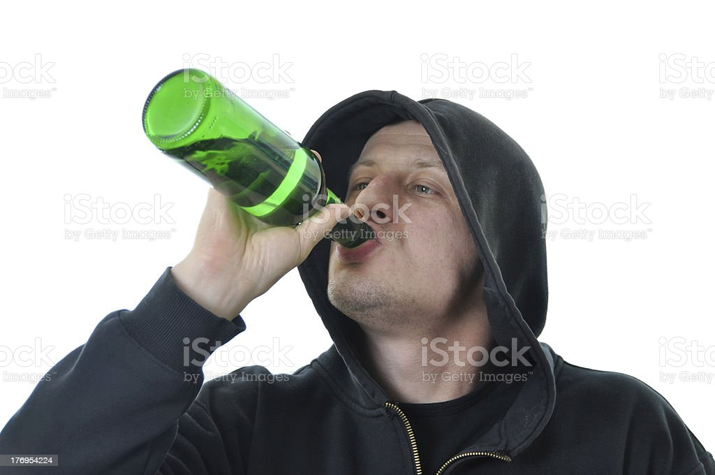 Young man drinking alcohol isolated foto