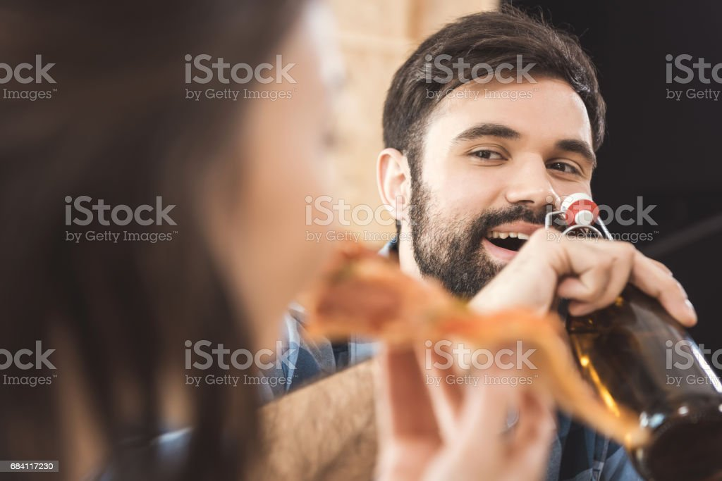 young man drinking beer royalty free stockfoto