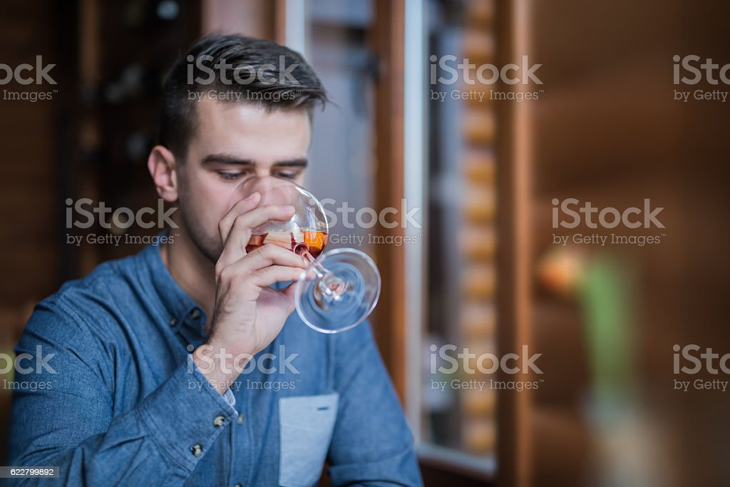 Young man drinking sangria in the restaurant stock photo