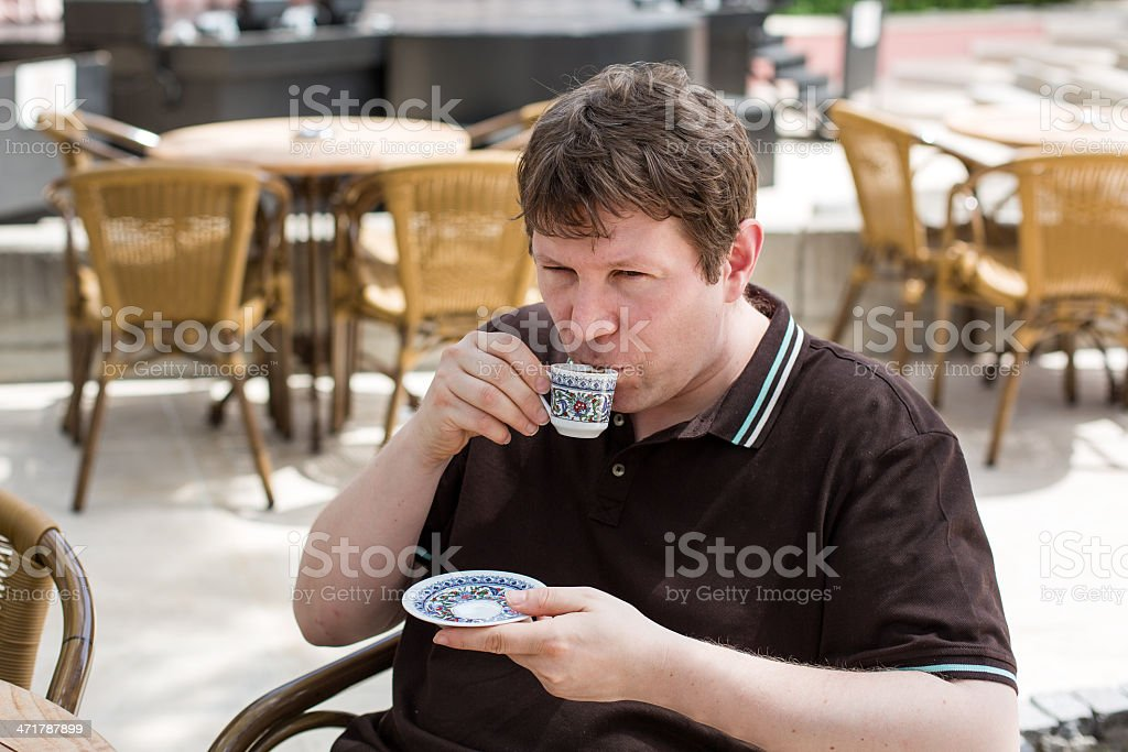 Young man drinking traditional turkish mocca coffee royalty-free stock photo