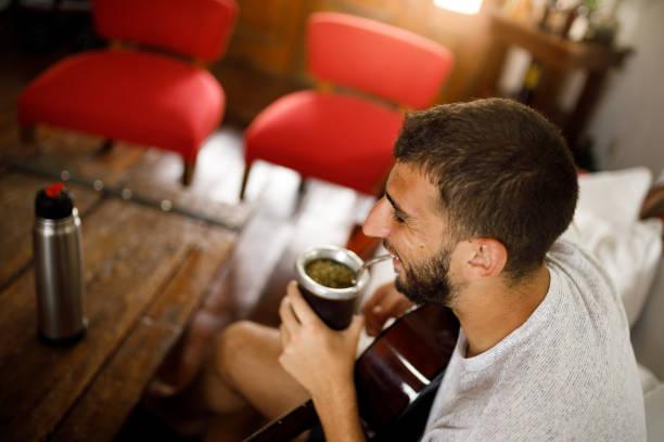 Young man drinking yerba mate - chimarrão stock photo