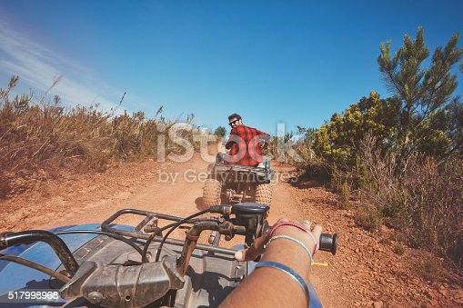 istock Young man driving ATV in nature 517998968