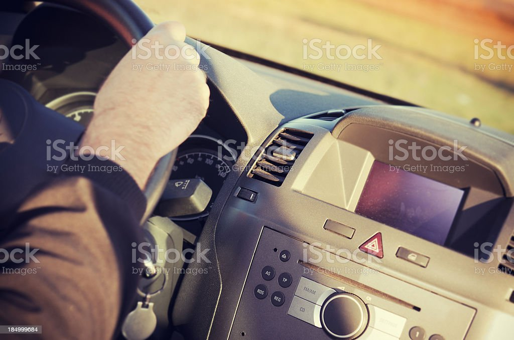 Young man driving his car with dashboard royalty-free stock photo