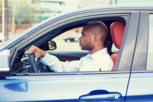 Young Man Driving His New Car Stock Photo - Download Image Now