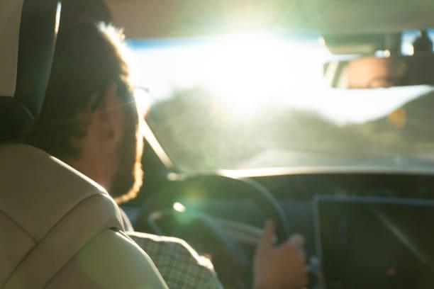 young man driving his new hydrogen car - pila a idrogeno foto e immagini stock