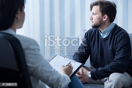 istock Young man during psychological therapy 512885370