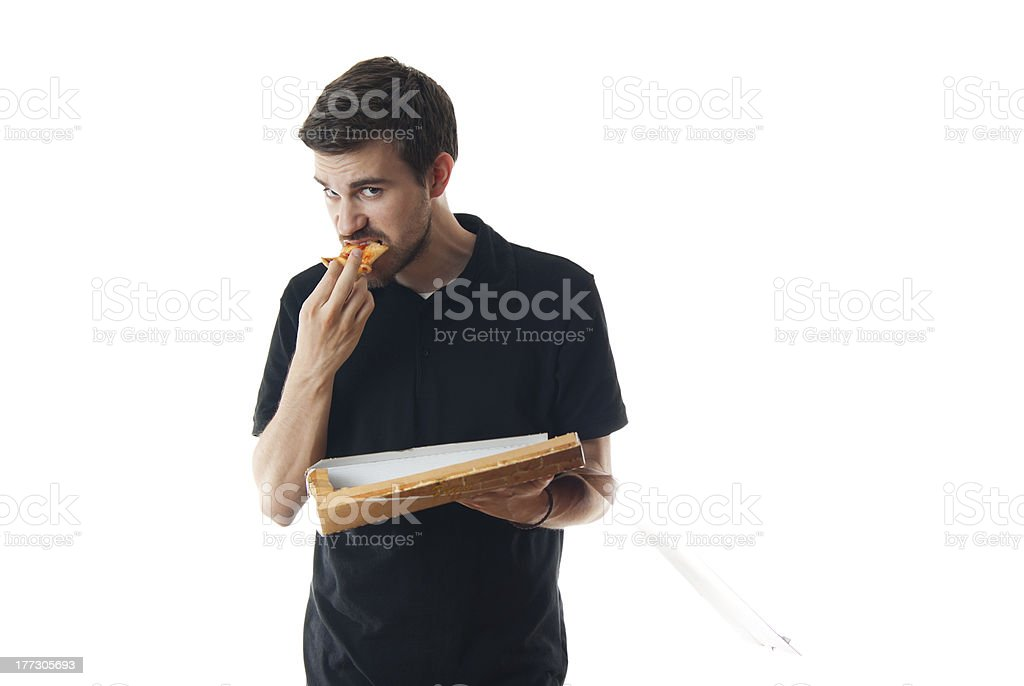 Young man eating pizza royalty-free stock photo