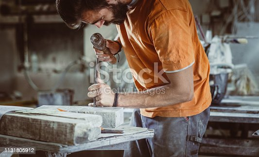 Young Man Engraving Stone