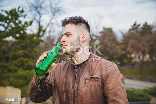 Young man enjoy in beer outdoor