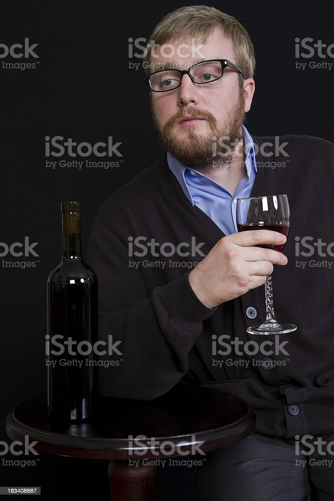 Young Man Enjoying a Glass of Wine stock photo