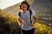 Young man enjoying a hike on a sunny day.