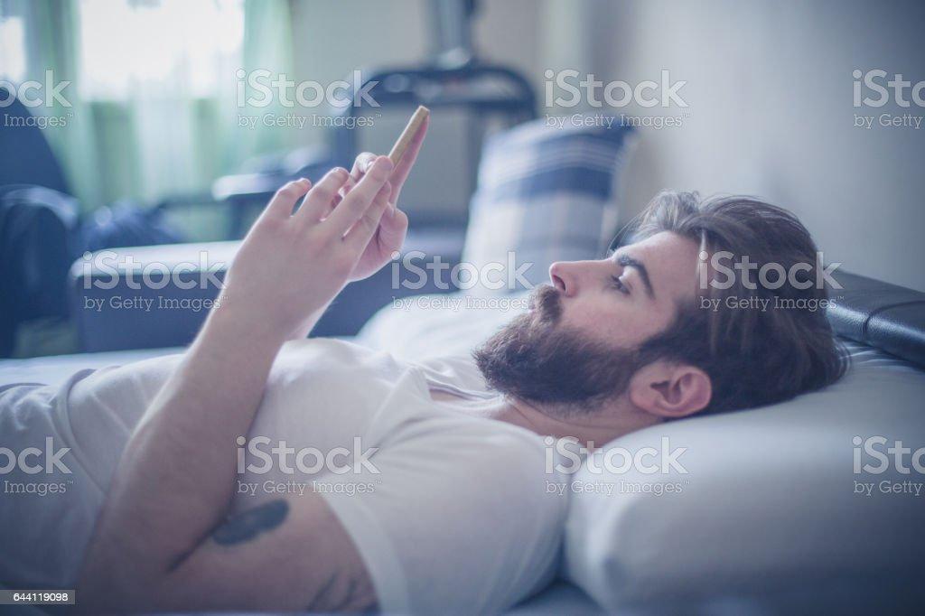 Young man enjoying at home stock photo
