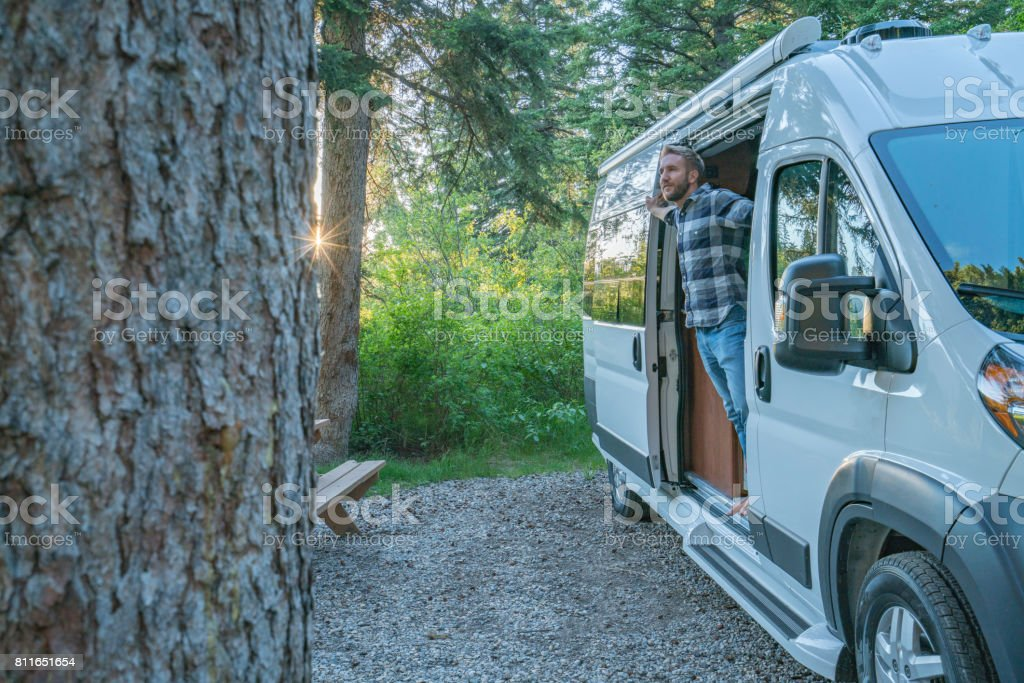 Young man enjoying camping life stock photo