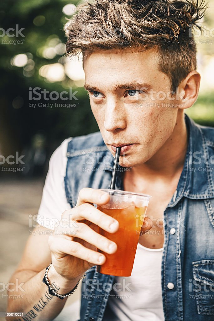 Young Man Enjoying Drinking Outdoors royalty-free stock photo