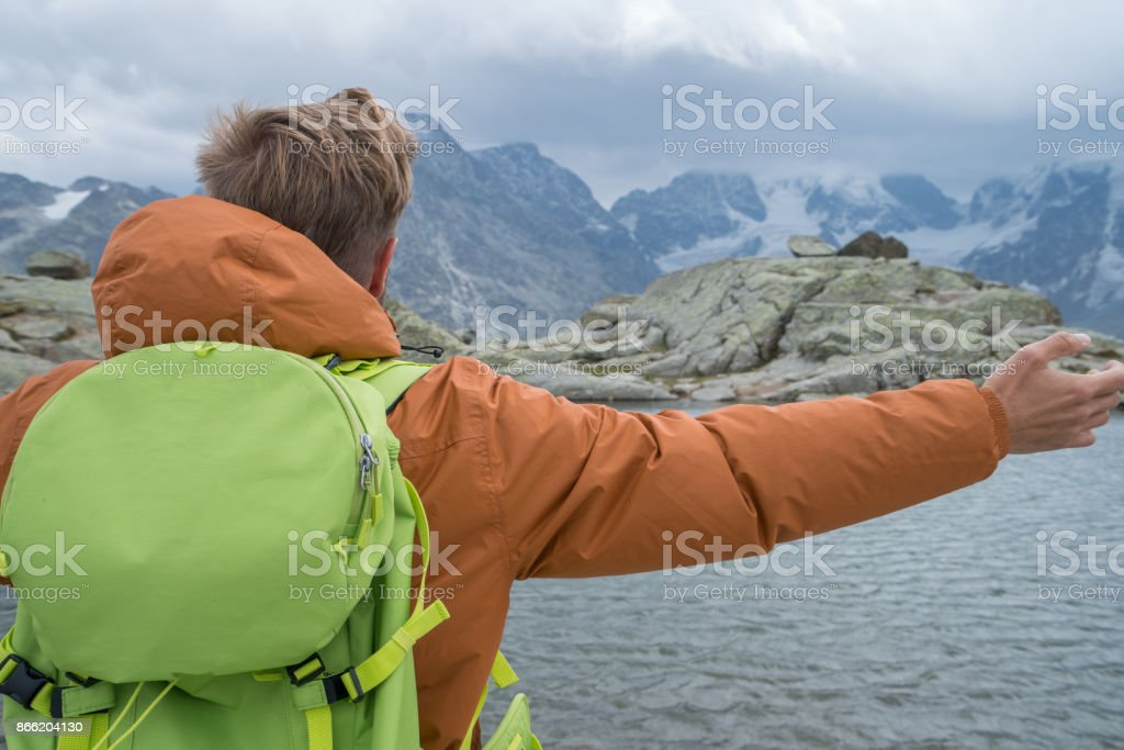Young man enjoying freedom in nature, arms outstretched stock photo