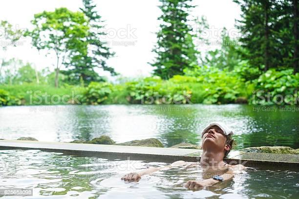 Young man enjoying hot spring water on hokkaido japan picture id625688098?b=1&k=6&m=625688098&s=612x612&h=6oa9kadlkx7xfaus5rkxnbtq08u6smvkwjp4e1yln88=