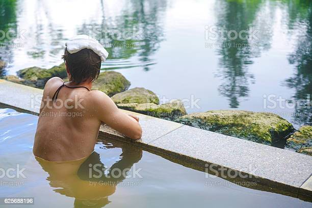 Young man enjoying hot spring water on hokkaido japan picture id625688196?b=1&k=6&m=625688196&s=612x612&h=j8z7y5lyrkpazh3ystgm2y vcpdxiocketeh0ajhrew=