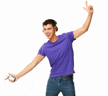 Happy young man in casual wear enjoying music on cell phone. Square. Isolated on white.