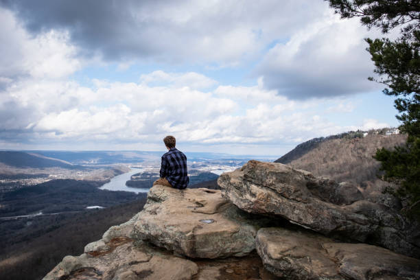 Young Man Enjoying the View from Lookout Mountain A young man enjoying the view from Sunset Rock on Lookout Mountain, outside of Chattanooga Tennessee. tennessee river stock pictures, royalty-free photos & images