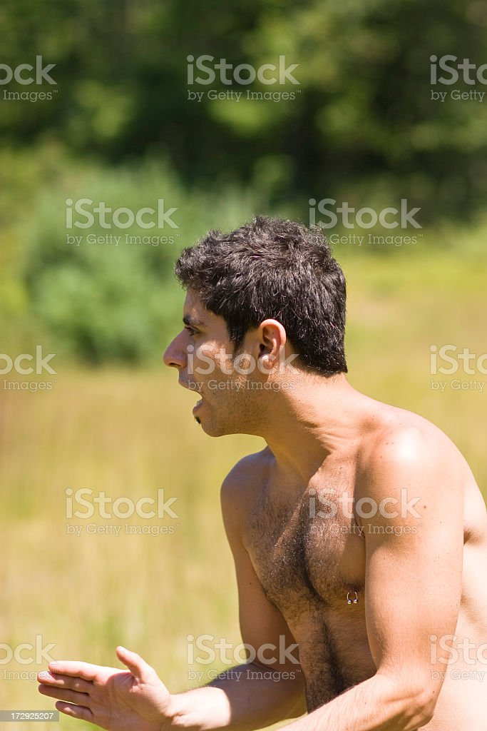 Young man enthusiastically yelling royalty-free stock photo