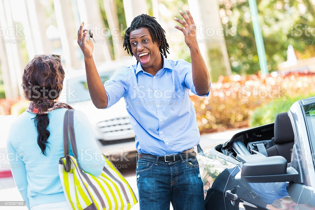 Young man excited about his new car stock photo