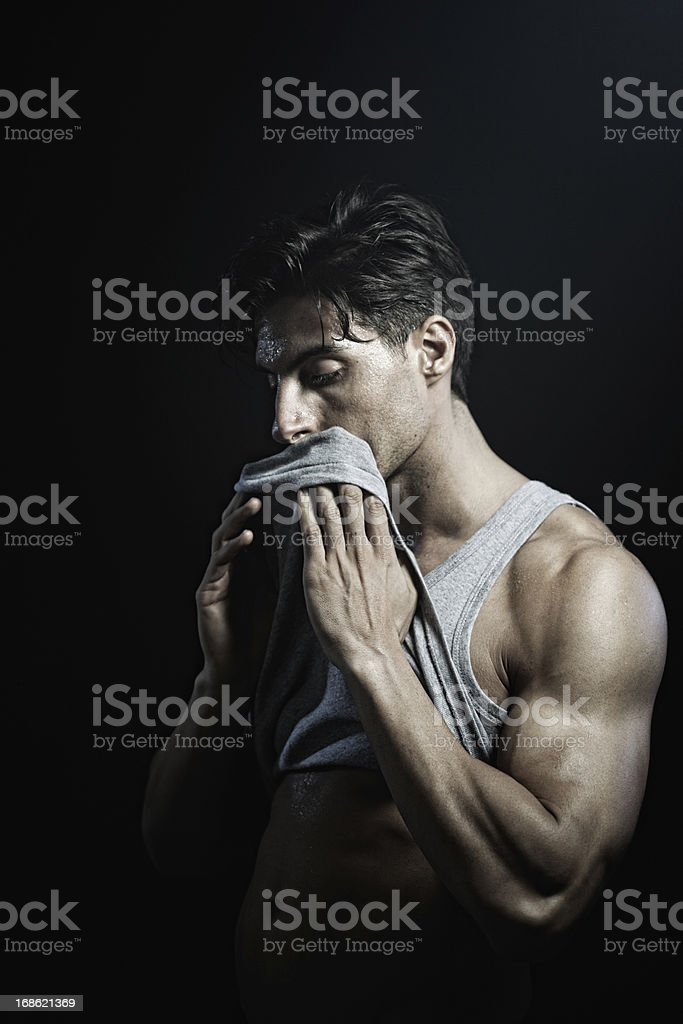 Young man exercicing in the gym. royalty-free stock photo
