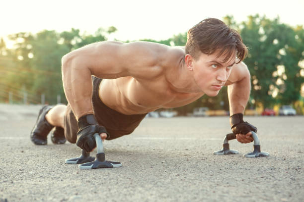 Young man exercise outdoors sport concept stock photo