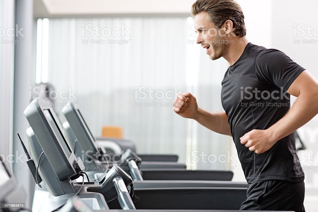 Young man exercising at the gym stock photo