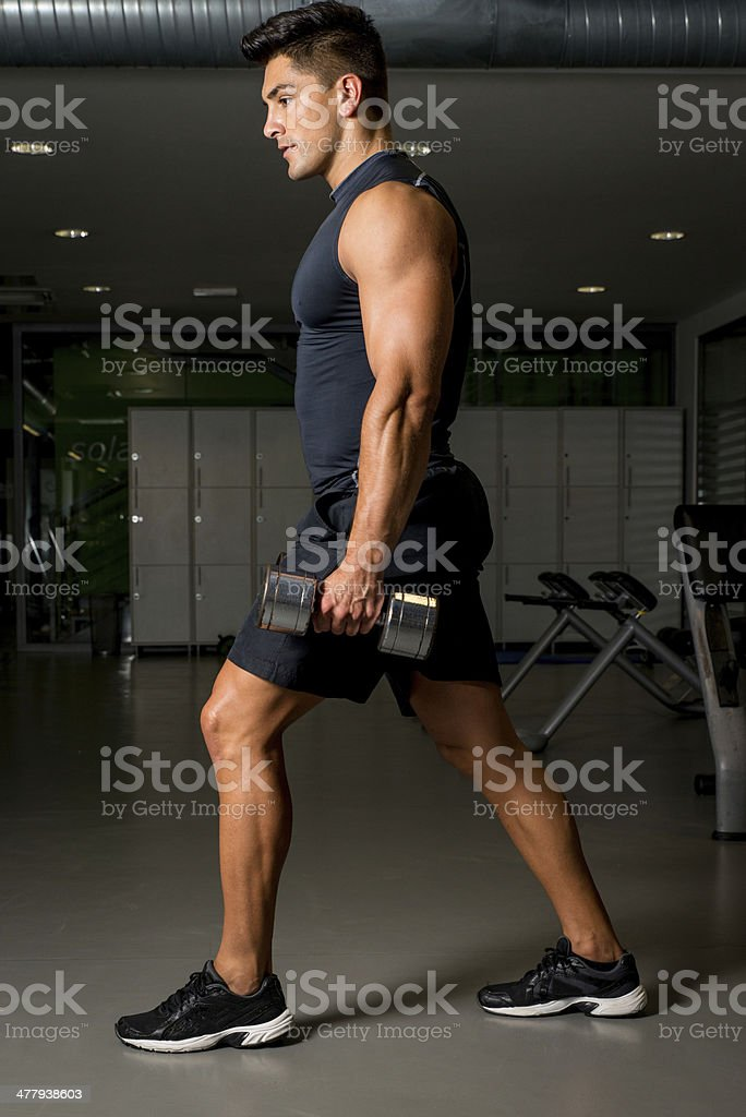 Young Man Exercising Lunges with Weights royalty-free stock photo