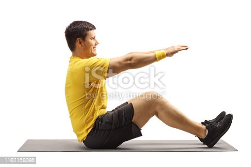 Young man exercising on an exercise mat isolated on white background
