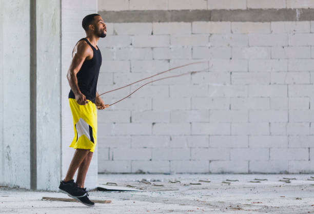 Young man exercising outdoors stock photo