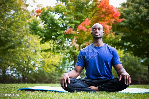 istock young man exercising yoga 612650676
