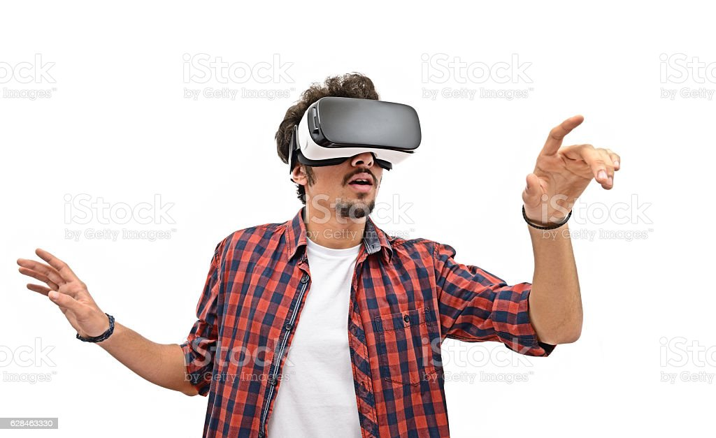 Young man experience with VR headset - Photo