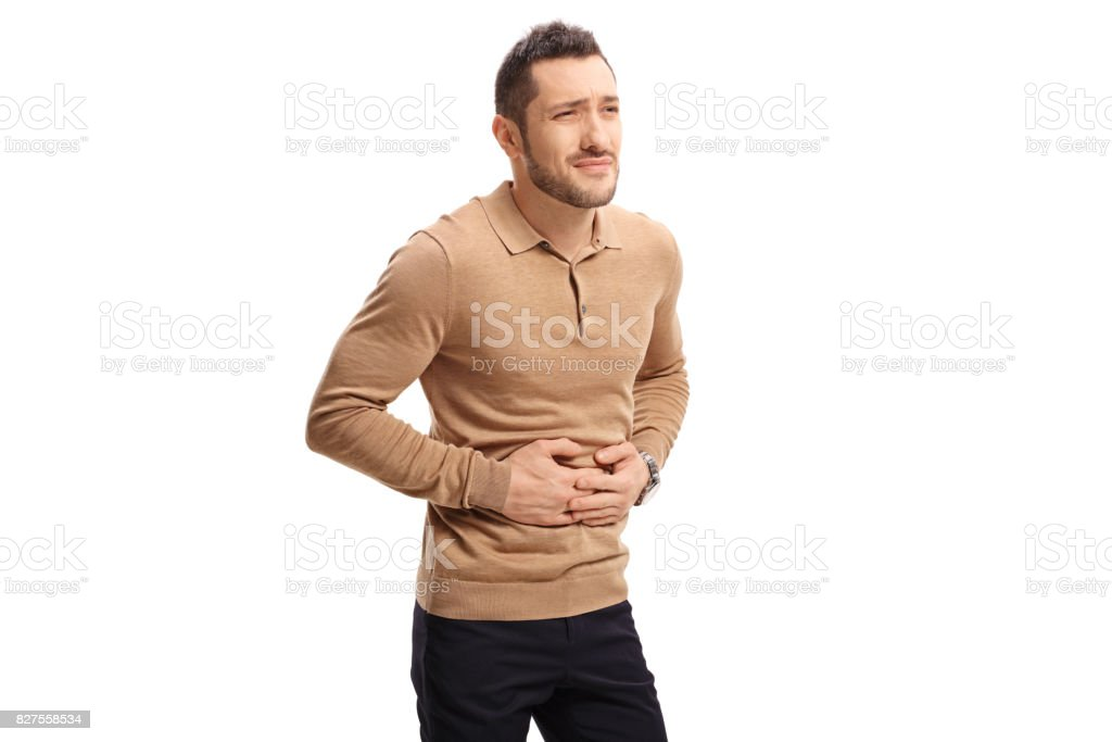 Young man experiencing stomach pain stock photo
