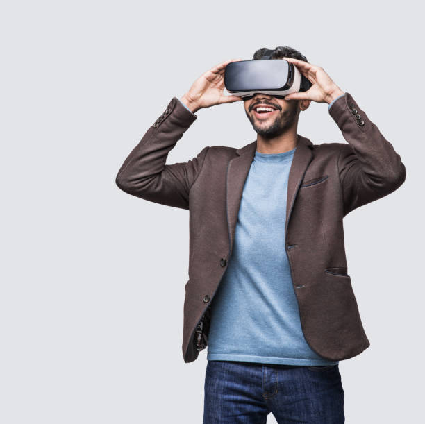 Young man experiencing virtual reality eyeglasses headset stock photo