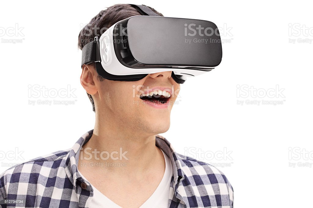 Young man experiencing virtual reality stock photo