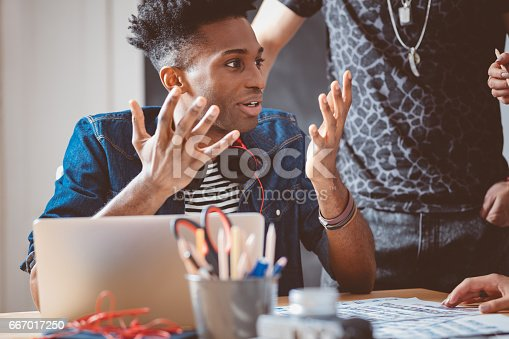 918746260istockphoto Young man explaining ideas to creative team 667017250