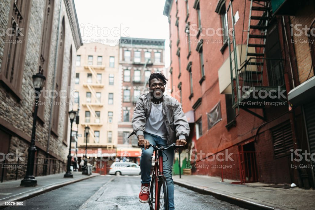 Young Man Exploring New York City by Bike stock photo