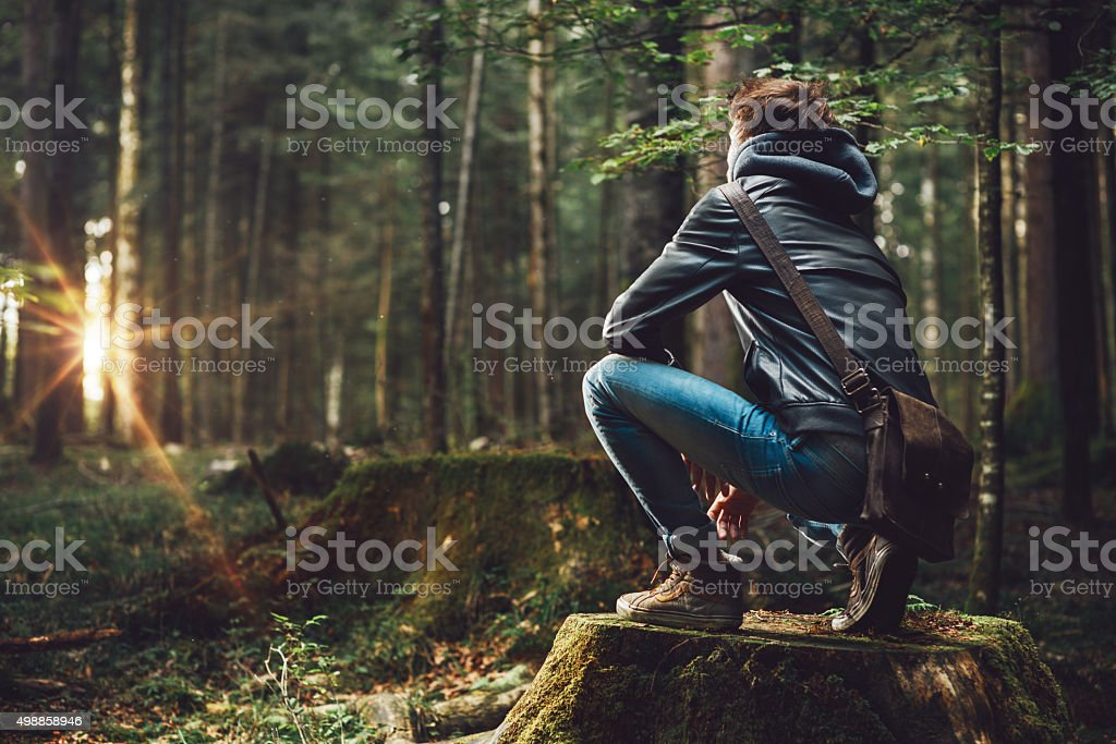 Young man exploring the forest stock photo