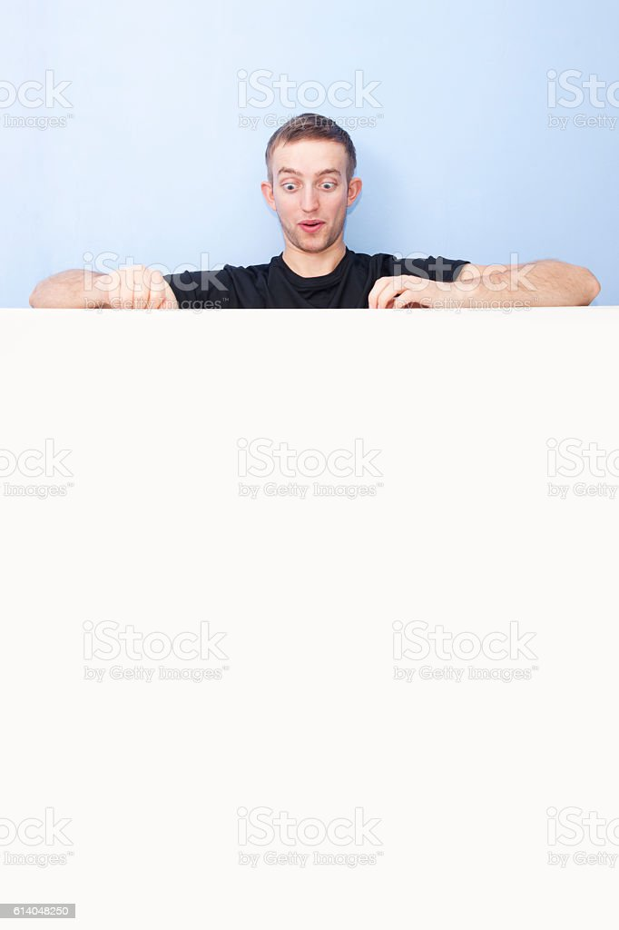 young man eyes widened in surprise stock photo