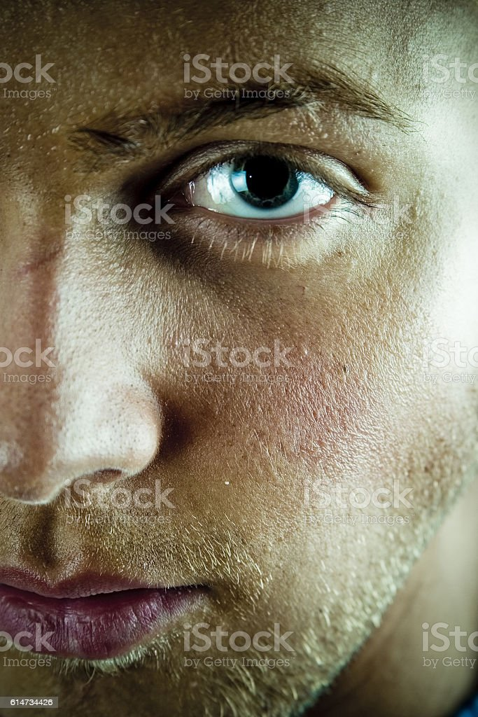 Young man face and eye stock photo