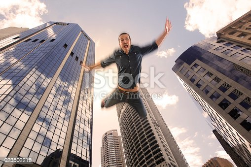istock Young man falling down of a building 623502218