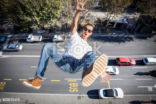 istock young man falling down of a building 623515410