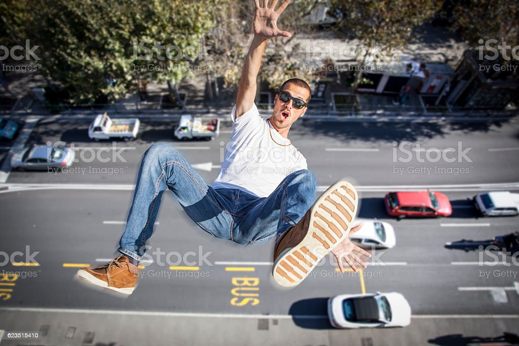 young man falling down of a building stock photo