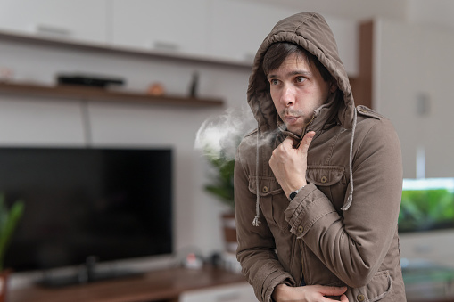 Young Man Feel Cold At Home Stock Photo - Download Image Now