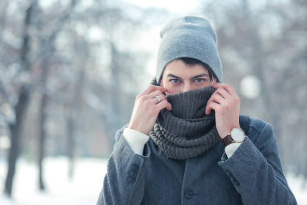 young man feeling cold stock photo
