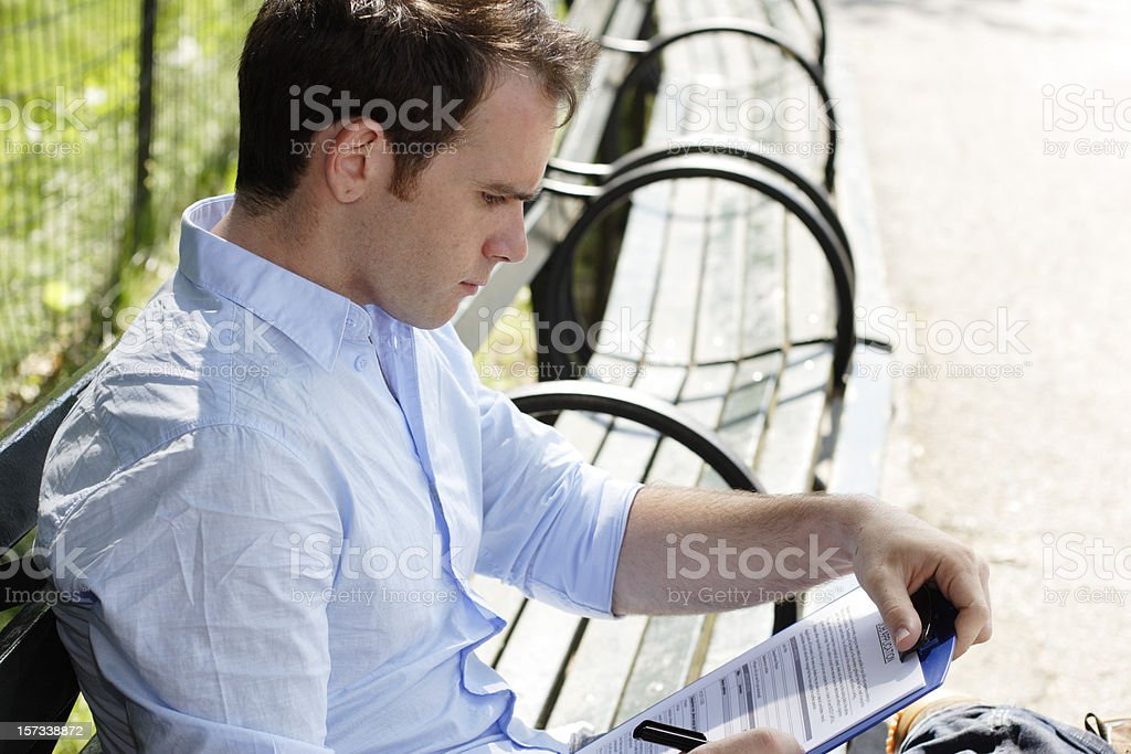 Young Man Fills Out Job Application royalty-free stock photo