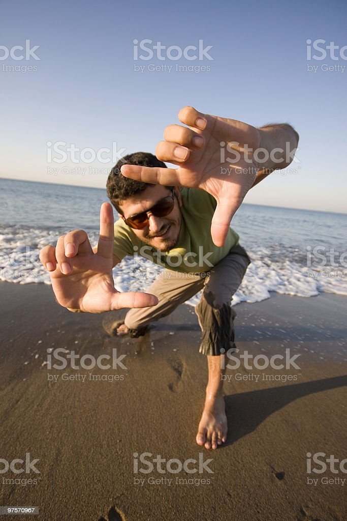Young man finger framing himself royalty-free stock photo